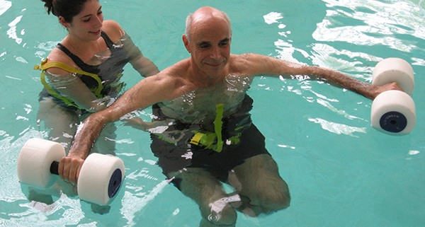 man receiving aquatic therapy