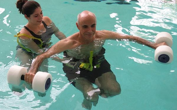man receiving aquatic therapy
